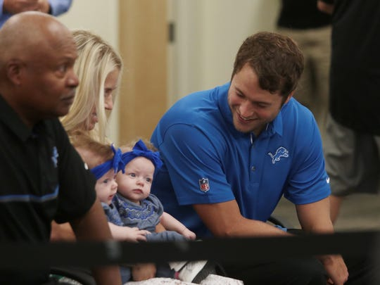 Detroit Lions quarterback Matthew Stafford sits with his wife Kelly B. Stafford and their twins Sawyer and Chandler Stafford before a press conference about his $135 million five-year contract extension at the Detroit Lions Training Camp in Allen Park on Tuesday August 29, 2017.