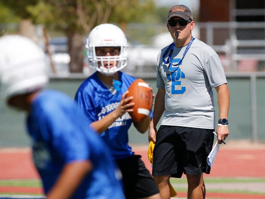 First-year head coach Ray Aguilar puts his San Elizario Eagles through a practice recently at the school's football field. Aguilar will try to bring life to a program that hasn't won a title since 1999.