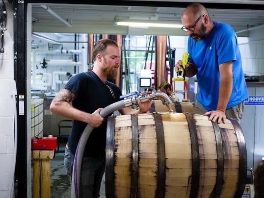 636075678076316131-filling-barrels2.jpg