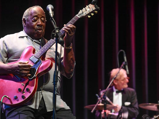 Albert White on guitar and Ardie Dean on drums, with the Music Maker Blues Revue, entertain blues fans at the Henderson Fine Arts Center Wednesday evening. The free concert was sponsored by the National Endowment for the Arts.
