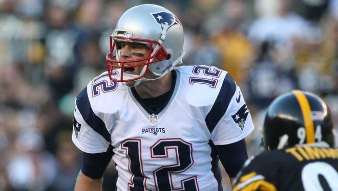 Patriots quarterback Tom Brady calls a play against the Steelers.
