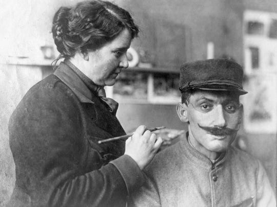 American sculptor Anna Coleman Ladd fits a soldier