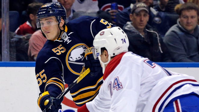 Montreal Canadiens defenseman Alexei Emelin, defending against Rasmus Ristolainen,was fined more than $11,000 for a head hit on Brian Gionta.