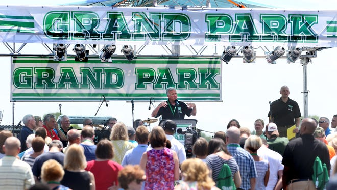 Westfield officials are betting that two new lease deals for Westfield's planned indoor soccer arena will net enough payments to cover debt service. Here, Westfield Mayor Andy Cook is shown speaking to the public at the grand opening for Westfield's Grand Park on June 21, 2014. City officials hope the indoor soccer arena will help draw visitors to Grand Park.