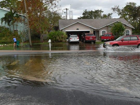 Scenes in Merritt Island on Monday following the heavy rains that hit Brevard on Sunday.