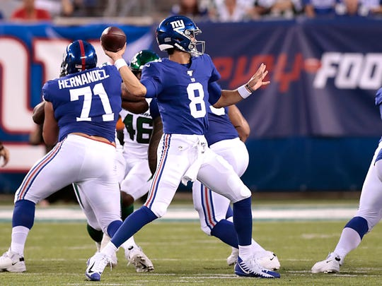 Aug 8, 2019; East Rutherford, NJ, USA; New York Giants quarterback Daniel Jones (8) throws the ball in front of offensive guard Will Hernandez (71) during the first half against the New York Jets at MetLife Stadium. Mandatory Credit: Vincent Carchietta-USA TODAY Sports