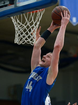 Green Bay Southwest's Noah Meyer (44) lays up a shot  in the second quarter during Tuesday night's WIAA Div. 2 regional game against Marinette at Green Bay Southwest High School. Evan Siegle/Press-Gazette Media