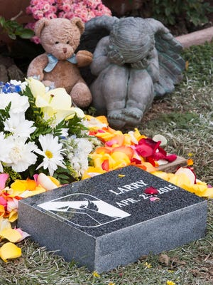 A headstone, flowers and other items are provided to abandoned babies formerly buried in graves for the destitute during memorial services at the Garden of Innocence by the Sea in the Ivy Lawn Memorial Park in Ventura. There will be a service Saturday for seven babies, and the public is invited to pay respects.