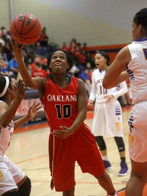 Oakland's Dekoria Puckett(10) goes up for a shot as Smyrna's Brianna Chapman (32) guards her on Monday, Feb. 20, 2017, during the third-place game of the 7-AAA tournament.