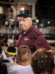 Bosco coach Greg Toal talks to his team after the Patriots defeated Bosco at American Heritage High School in Plantation, Fla.