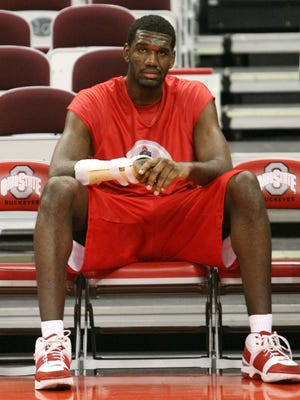 Ohio State freshman center Greg Olden sits on the bench before an exhibition college basketball game against Findlay in Columbus, Ohio, Wednesday, Nov 1, 2006. With jaw-dropping skills at both ends of the floor, Oden is the most highly anticipated college freshman to come along in a generation or two.