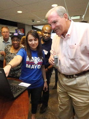 El Paso mayoral candidate Dee Margo, right, looks at election returns with his campaign manager, Olivia Zepeda, at his election night watch party at the WestStar Bank Club inside Southwest University Park.