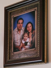 Eduardo Sanchez, Maria Ibrra and daughter Citalaly Sanchez, in an old family picture seen in their far east side home, Indianapolis, Tuesday, May 23, 2017.