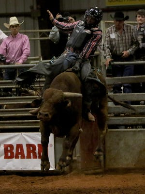 Clayton Appelhaus rides a bull Saturday, Nov. 11, 2017, in the Texoma Cowboy Church Bull Bash at the J.S. Bridwell Agricultural Center.