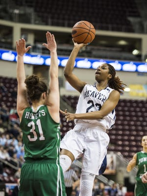 Lebanon Catholic's Alexis Hill drives to the hoop against Juniata Valley's Halee Smith as Lebanon Catholic defeated Juniata Valley 55-43 in the PIAA Class 1A state championship on Friday, March 24, 2017 at the Giant Center.