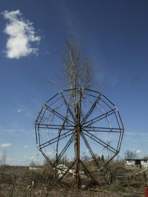 A tree grows through the middle of the Ferris wheel at the old Chippewa Lake Park on April 1, 2009, in Chippewa Lake Village.