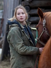 """""""Winter's Bone""""   Director: Debra Granik.   Cast: Jennifer Lawrence, John Hawkes, Dale Dickey.   Rating: R for drug material, language and violent content.   Jennifer Lawrence is brilliant as a 17-year-old girl in the Ozarks searching for her on-the-lam, meth-cooking father in """"Winter's Bone."""""""