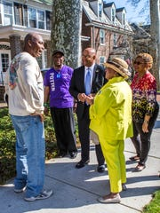 Former Philadelphia Mayor Michael Nutter (center) speaks to Romain Alexander (left) with Rep. Charles Potter Jr. (second from left), Rep. Stephanie Bolden (second from right) and Councilwoman Hanifa Shabazz (right) while canvassing for Hillary Clinton in Wilmington on Sunday afternoon.
