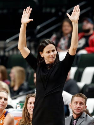 Phoenix Mercury coach Sandy Brondello sends a signal to the officials on a call in the second half of a WNBA playoff semi-finals basketball game against the Minnesota Lynx Wednesday, Sept. 28, 2016, in St. Paul, Minn. The Lynx won 113-95.
