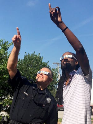 The City of Jackson Police Chief Julian Wiser and Jackson Sun Photographer Kenneth Cummings test out their solar eclipse glasses, Monday morning in preparation for the event this afternoon. It is said that from Jackson, viewers can see 97% of the sun covered by the moon.