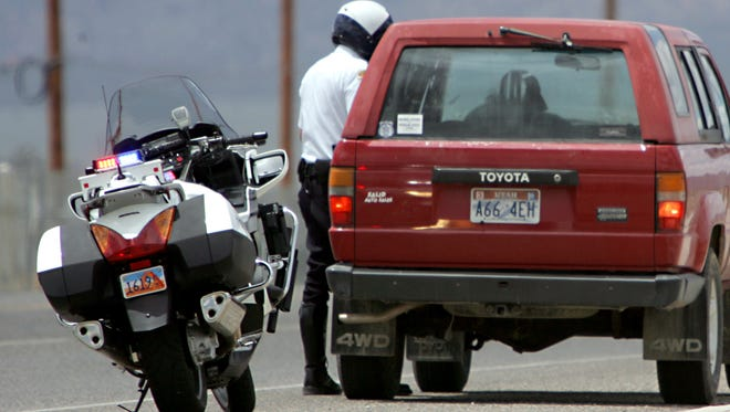 Cedar City Police Officer Tyson Fischer talks with a motorist along Highway 56 in Cedar City in this file photo.