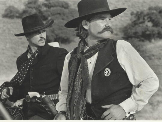 "Val Kilmer (left) and Kurt Russell star in ""Tombstone"" (1993)."