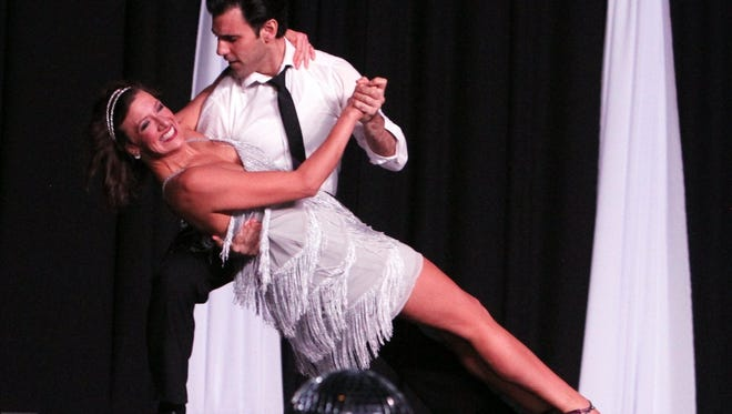 Dancing for the Stars participants take the floor Friday at the MPEC Exhibit Hall.