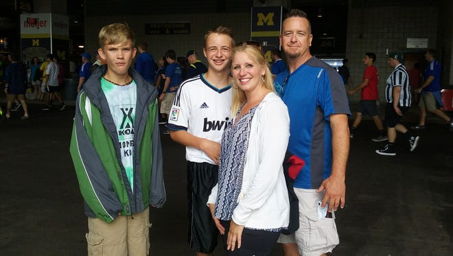 From left, Declan Fennelly, Jimmy Shereda, Becky Shereda and Jim Shereda of Lapeer attended Saturday's match at Michigan Stadium.