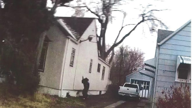 A still shot from a deputy's body camera shows Jessie Cedillo moments before he was shot and killed by the deputy. Investigators have determined that there is a gun in Cedillo's right hand. The district attorney has ruled the shooting to be justified.
