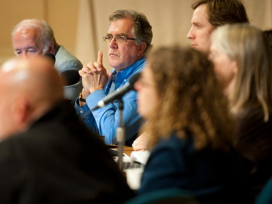 Burlington City Councilor Tom Ayres, D-Ward 7, listens to public comment in a late-2013 meeting at Contois Auditorium.