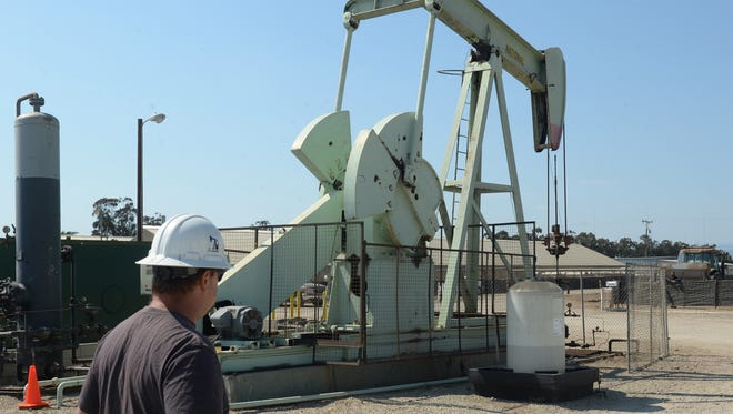 Zach Keller, a lease operator at Renaissance Petroleum is shown in this 2017 photo at a drilling site on Etting Road in an unincorporated area of Ventura County near Oxnard.