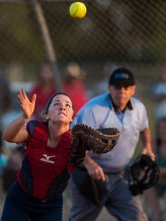 Master's Academy catcher Carina Fowler catches a bunt