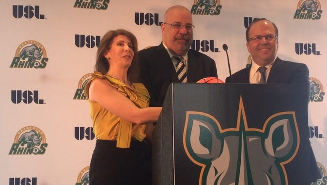 Wendy Dworkin, left, and David Dworkin, right, flank USL executive Tom Veit at Thursday's introductory news conference. The Dworkins are the new owners of the Rochester Rhinos.