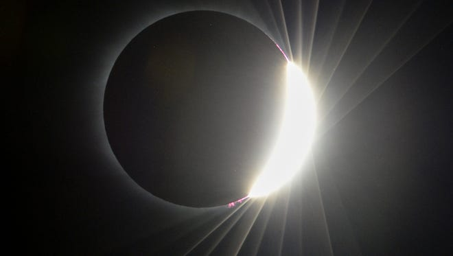 A glow around a total solar eclipse over Clemson University on Monday, August 21.