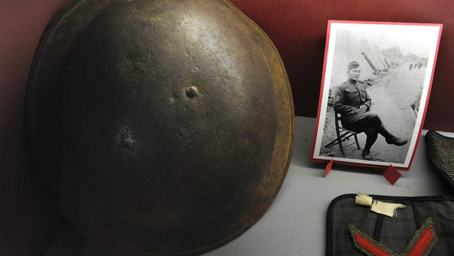 A photograph of Franklin Leroy Stewart — one of 118 Scurry County residents who served — and a World War I soldier's helmet are on display.