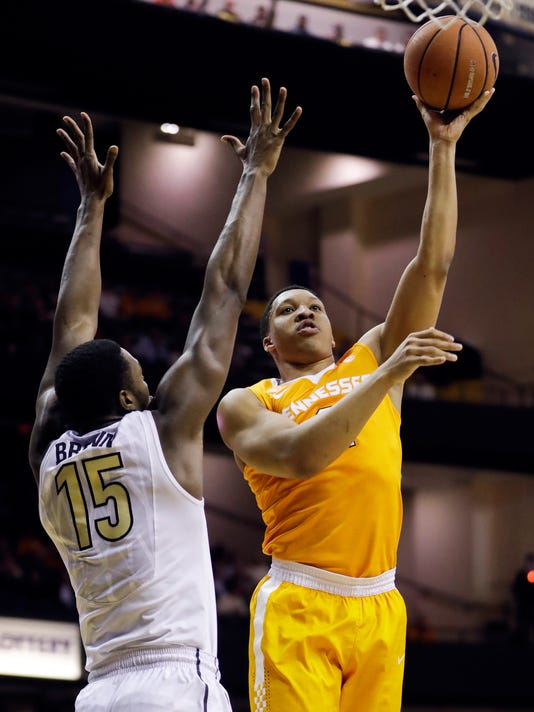 FILE -- In this Jan. 9, 2018 file photo, Tennessee forward Grant Williams, right, shoots against Vanderbilt forward Clevon Brown (15) during an NCAA college basketball game in Nashville, Tenn. Williams is one of the Tennessee players who spends time playing board games, rather than video games, with teammates on the road. (AP Photo/Mark Humphrey, File)