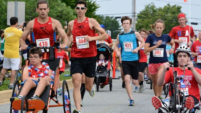 """People with different abilities participate in the inaugural """"Inclusion Means Everyone 5K"""" that took place July 4 in Newark. The race is raising funds to help properly teach Delaware's physical education teachers in Adaptive PE so all children can enjoy physical activity together."""