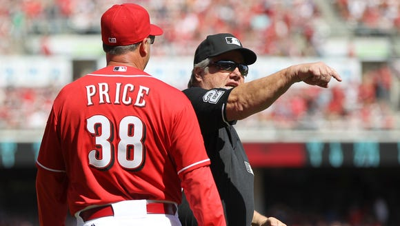 Cincinnati Reds manager Bryan Price, left, is ejected