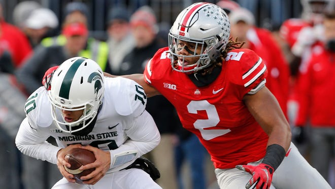 Michigan State Spartans quarterback Messiah deWeaver is sacked by Ohio State Buckeyes defensive end Chase Young during the second half at Ohio Stadium.