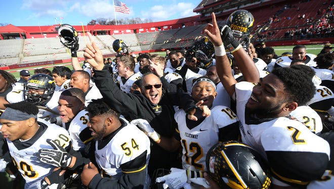 Piscataway celebrates after defeating vs. Manalapan in Central Group V sectional football championship at Rutgers University's High Point Solutions Stadium. Piscataway won the game 34-13. Dec. 3, 2016, Piscataway, NJ.