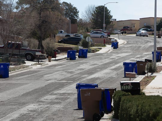 Recently emptied recycling containers — the blue bins — sit on Mercury Lane, Monday March 12, 2018. The city-county South Central Solid Waste Authority is now asking, but not requiring, residents to stop recycling certain types of materials.