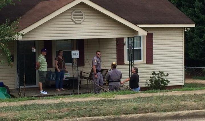 Three charged after FBI raid in Gaston County.