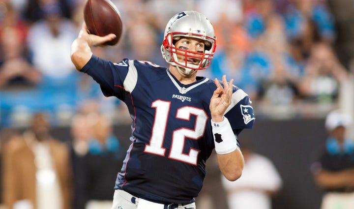 New England Patriots quarterback Tom Brady (12) passes
