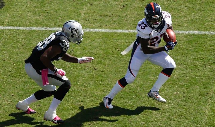 Ronnie Hillman #23 of the Denver Broncos avoids the