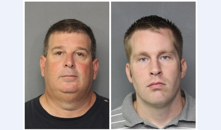 Two Norfolk police officers were charged with embezzlement.