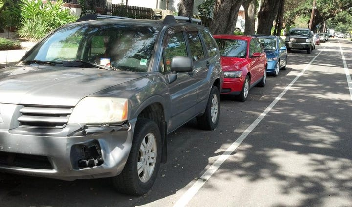 Vehicles parked in Mid-City