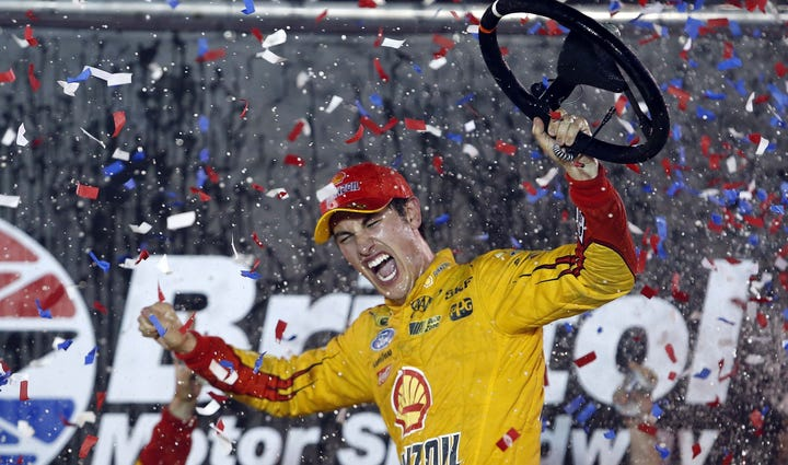 Sprint Cup Series driver Joey Logano (22) celebrates