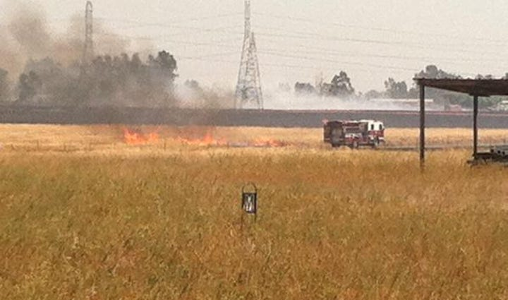 Firefighters battle a fire burning in Elverta.