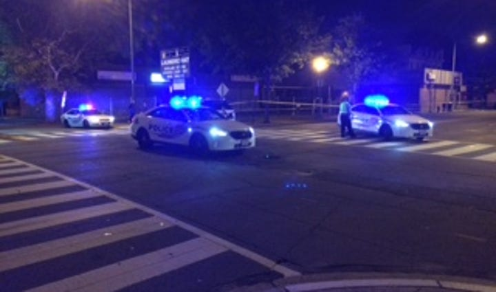 Police at the scene of a shooting at Georgia Avenue