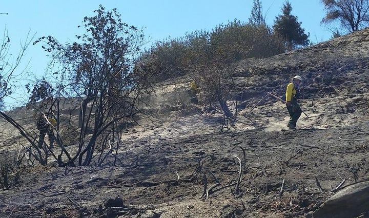 Crews mop up hot spots from the Sleepy Hollow Fire